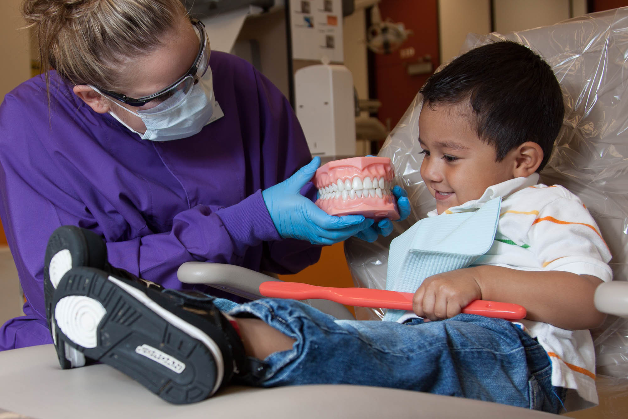 Dental student with a child patient