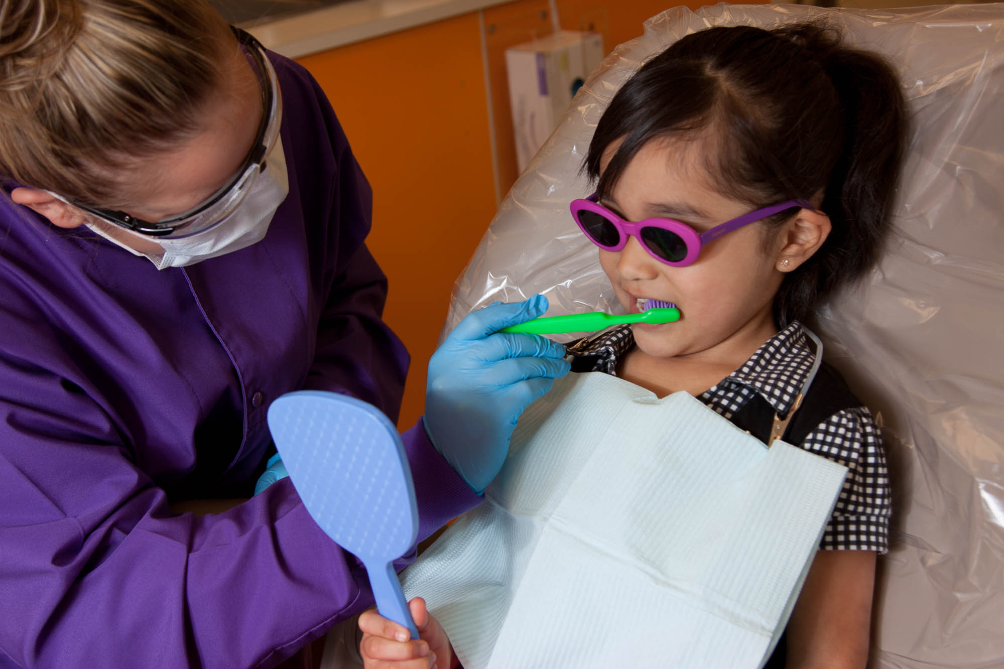 Dental student working with a young patient