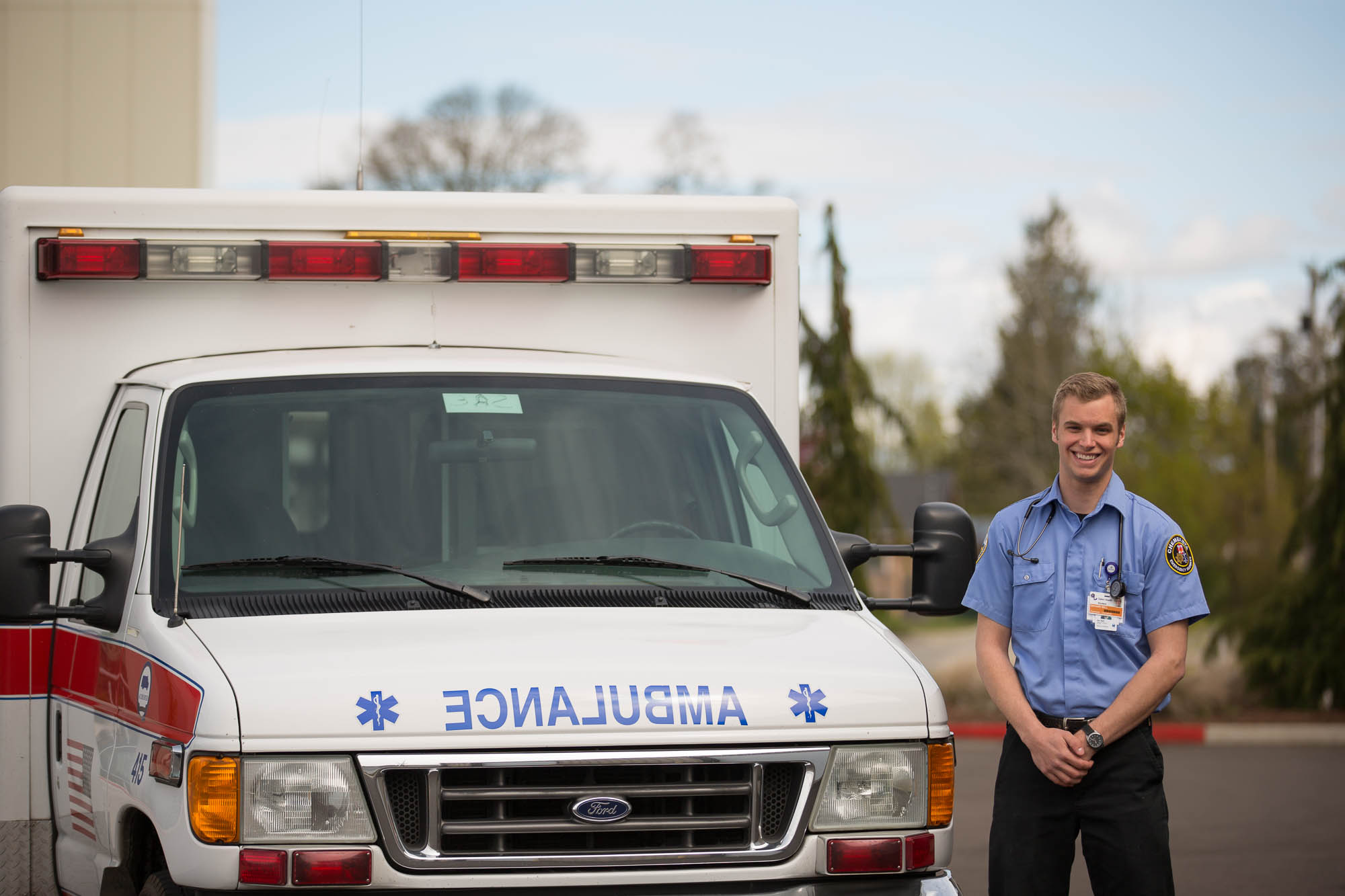 Emergency Medical Technician standing next to an ambulance