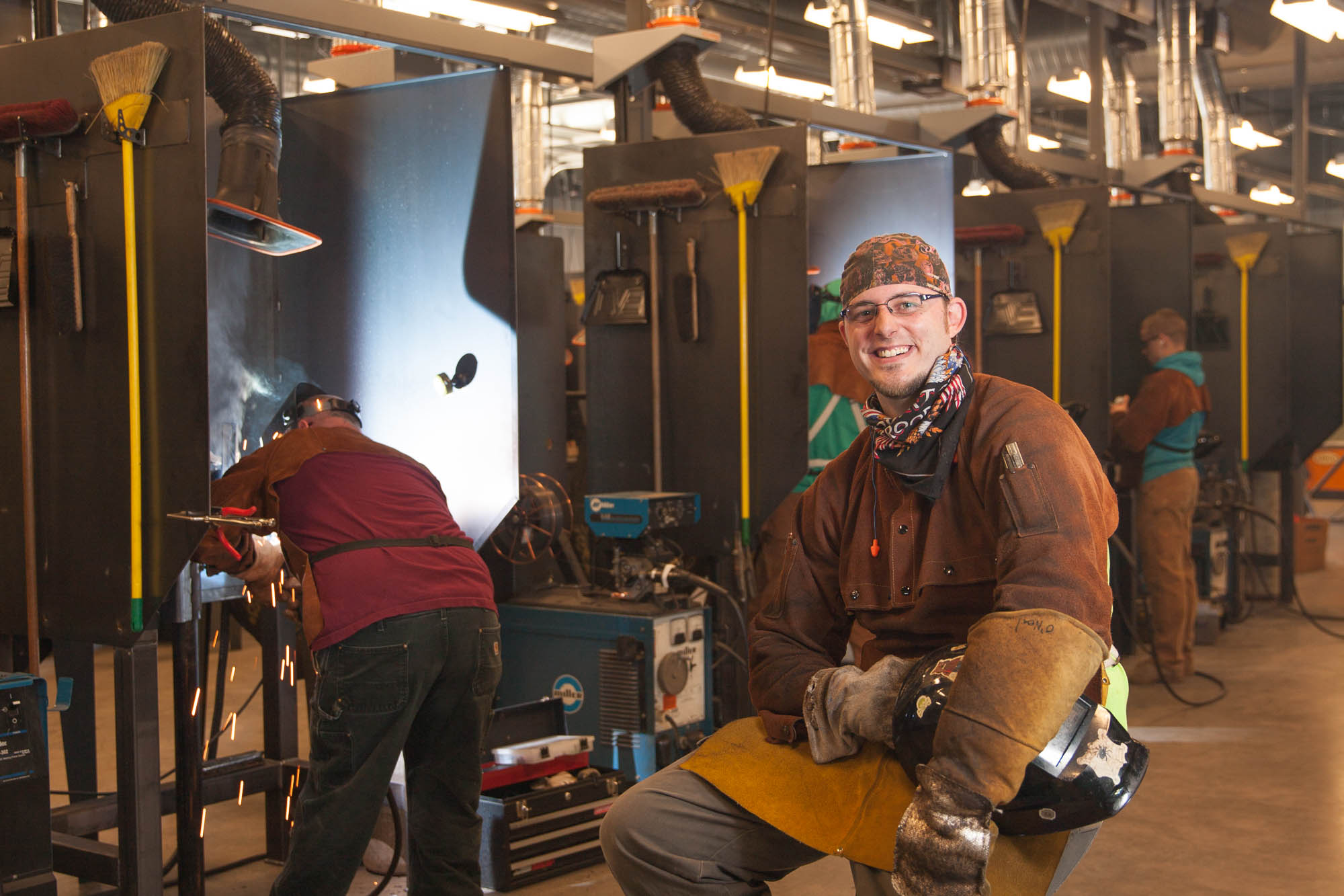 Welding student in welding shop