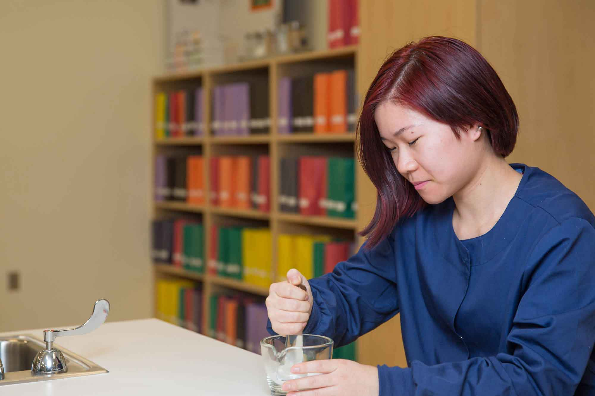 A student uses a mortar and pestle