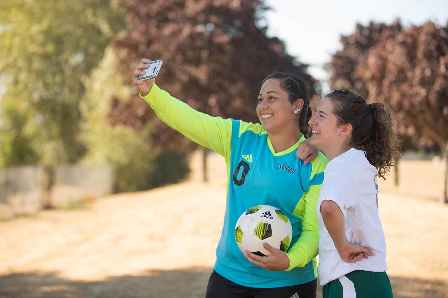 Two women soccer players taking a selfie