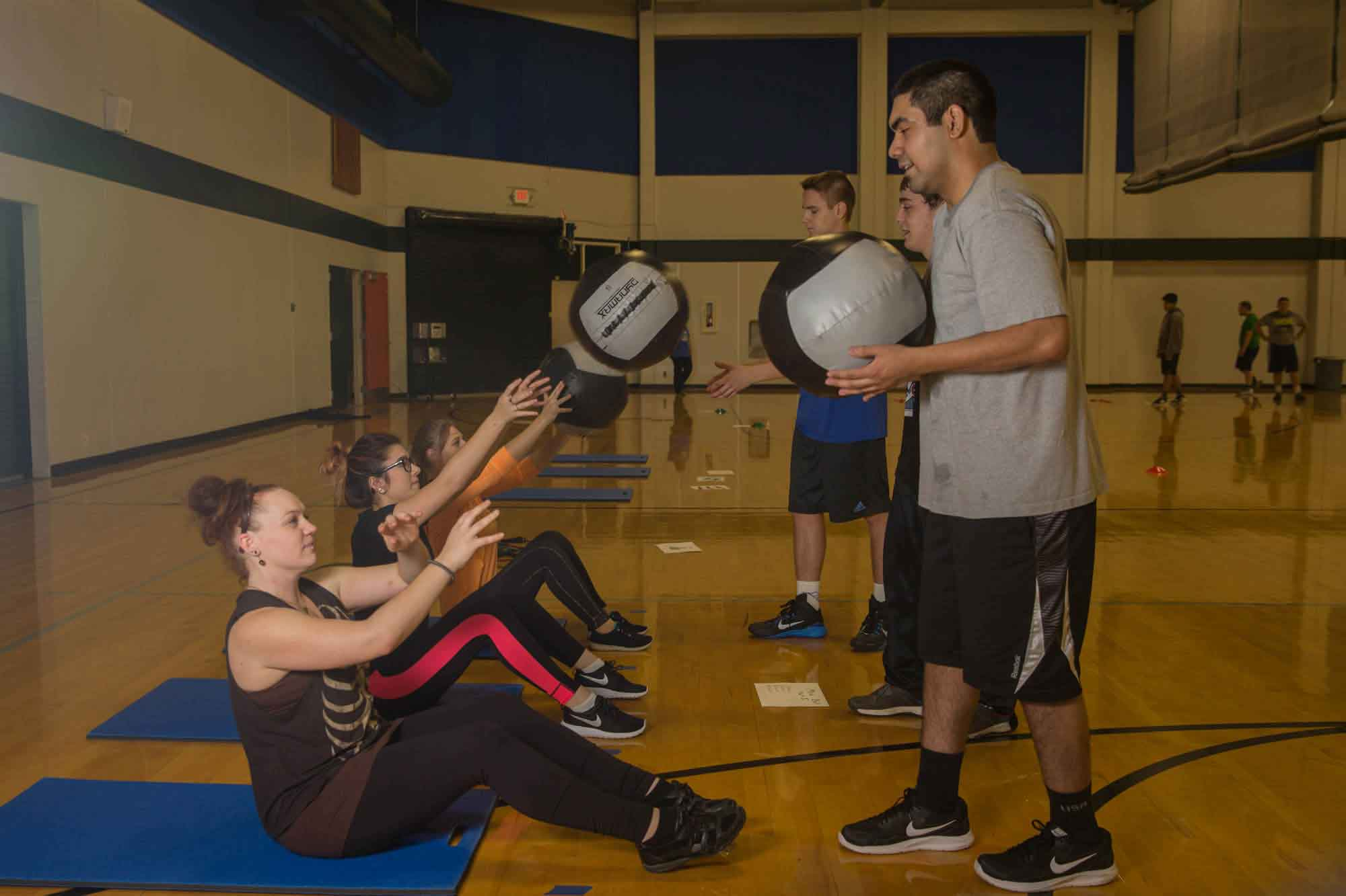 Students practicing with medicine balls